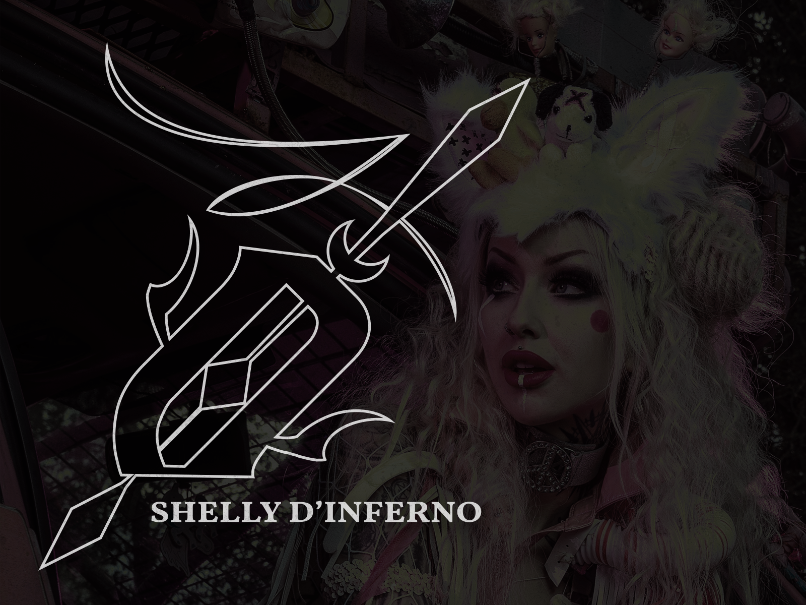 An emblem version of the logo created using the abstract sun symbol and sai sword with the words Shelly d'Inferno beneath.